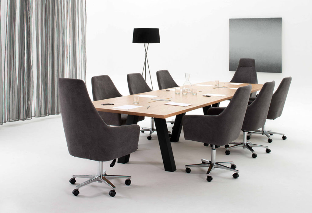 Spectre lounge chairs at meeting table